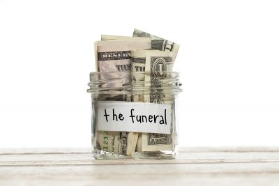 Save Download Preview Saving jar with money for the funeral on white wooden table