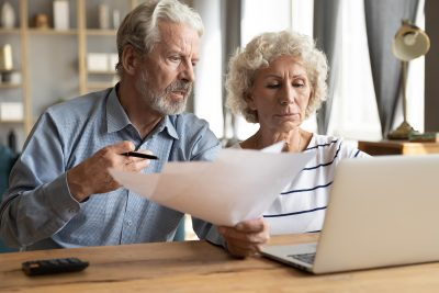 Save Download Preview Elderly couple manage budget having unpaid debts feels stressed